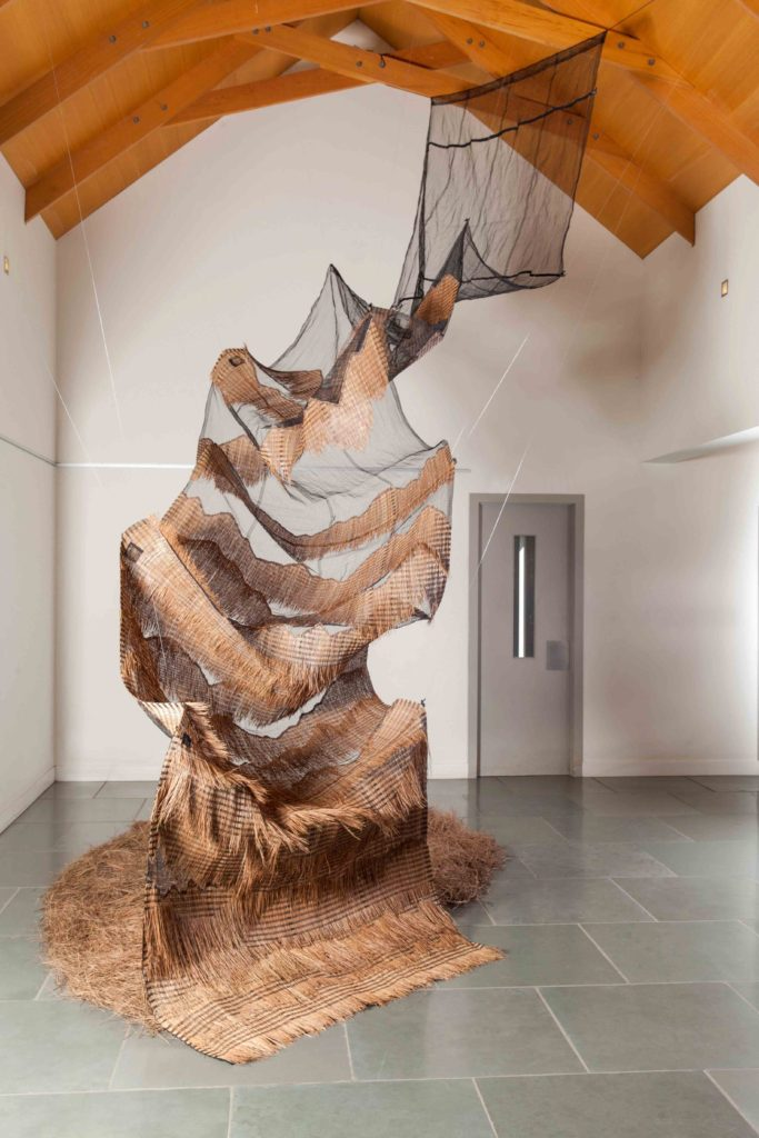 Carmel Wallace REFUGE 2017/8 Recycled safety-net, pine needles, thread. Size:variable (8m x 230cm x 15cm fully extended). photo by Kristian Laemmle-Ruff